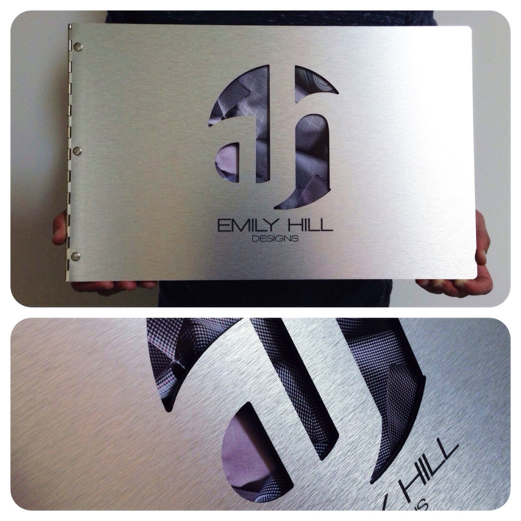Custom fashion design portfolio book with cut-out and engraving treatment on silver aluminum