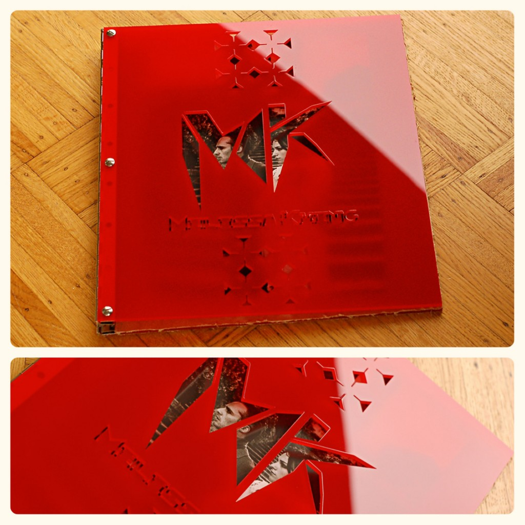 Custom fashion designer portfolio book in red acrylic with engraving and cut-out treatment