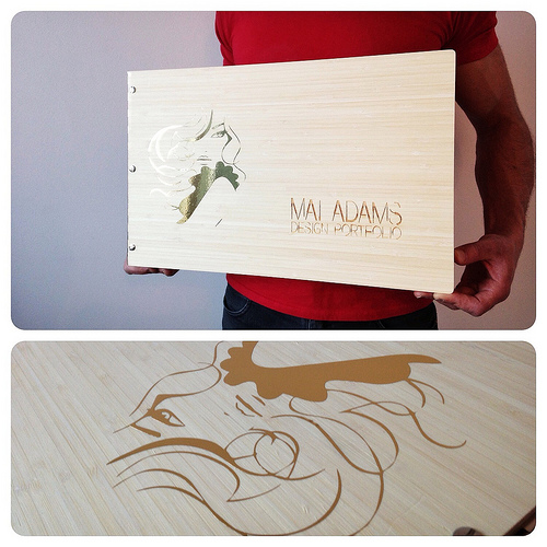 Custom-cut amber bamboo portfolio book with vinyl decal and engraving treatment