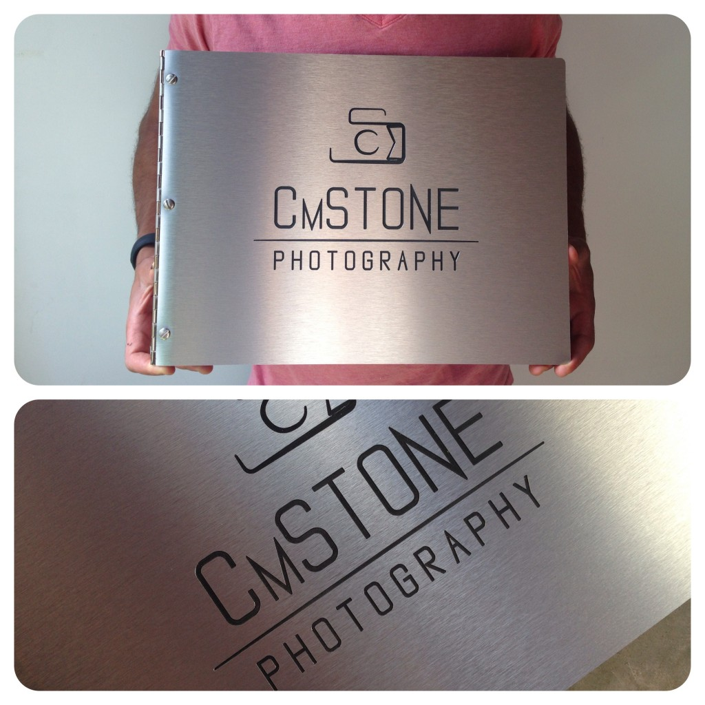 Custom photography portfolio book in brushed silver aluminum with engraving treatment