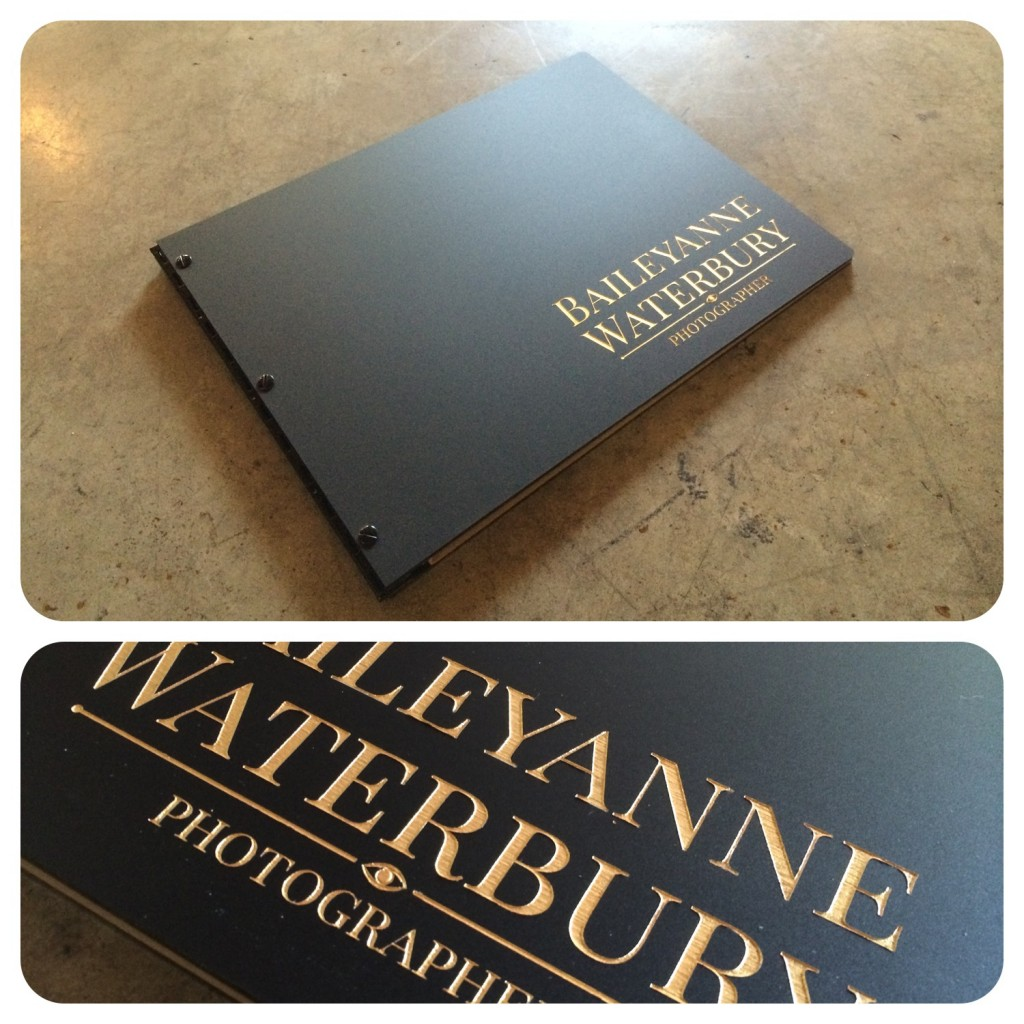 Custom photography portfolio book in matte black with engraved color fill treatment