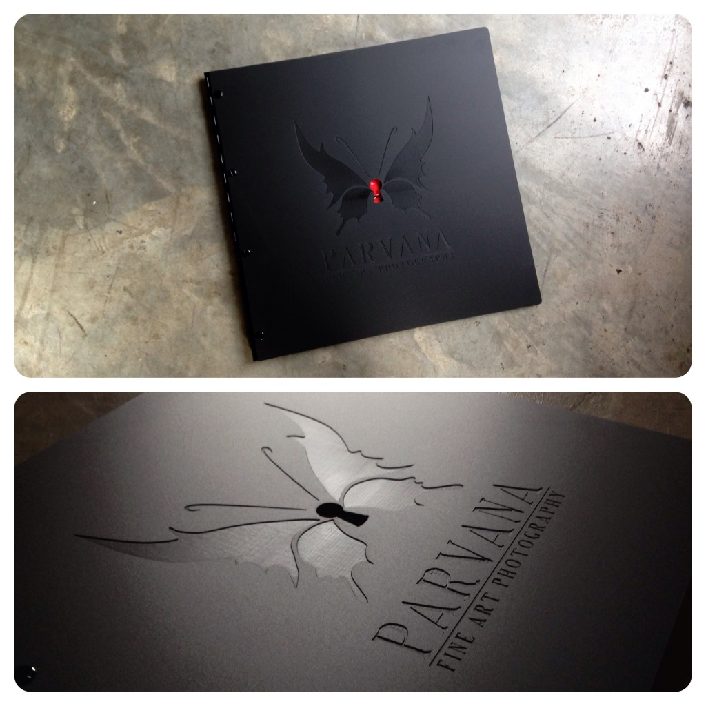 Custom photography portfolio book with engraving and cut-out treatment on matte black acrylic