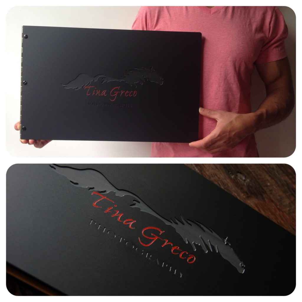 Custom photography portfolio book with engraving and red color fill treatment on matte black acrylic