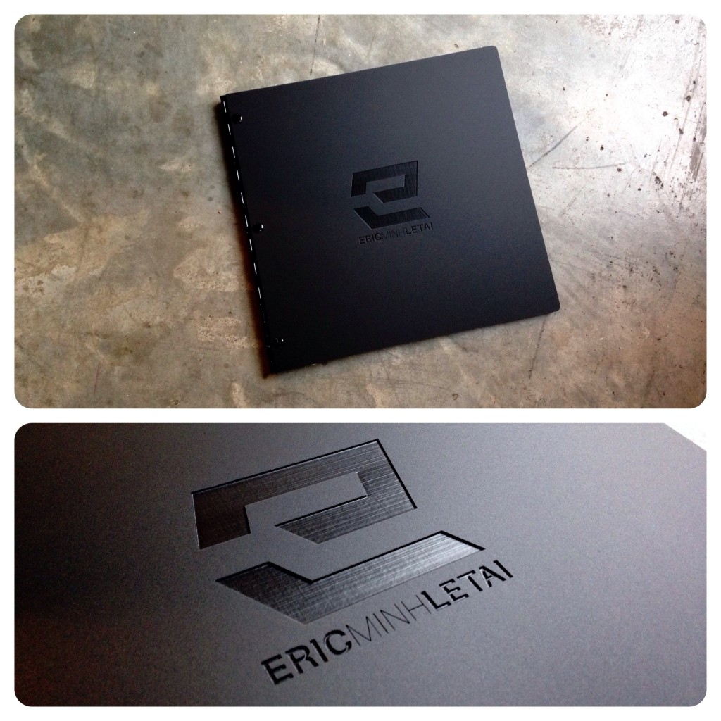 Custom square photography portfolio book with engraving treatment on matte black acrylic