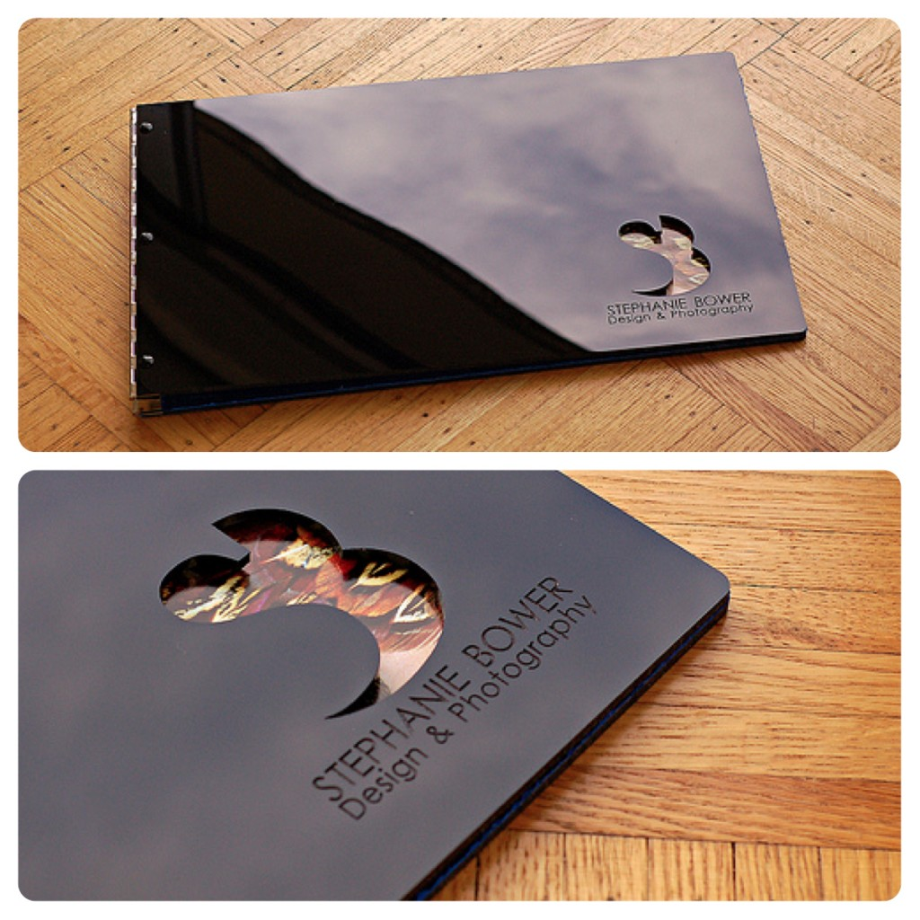 Custom photography portfolio book with engraving and cut-out treatment on glossy black acrylic