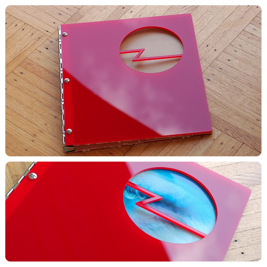 Custom photography portfolio book in red acrylic with cut-out treatment