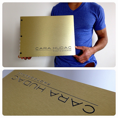 Custom photography portfolio book with engraving treatment on brushed gold aluminum