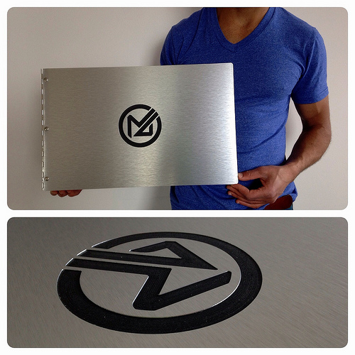 Custom photography portfolio book with engraving treatment on brushed silver aluminum
