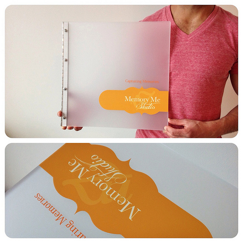 Custom wedding photography book with vinyl decal treatment on frosted clear acrylic