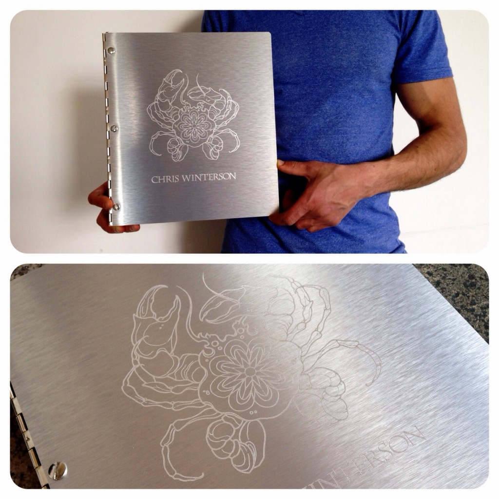 Custom tattoo portfolio book with burnishing treatment on brushed silver aluminum