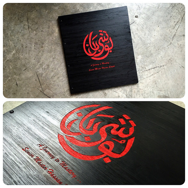 Custom ebony stained bamboo portfolio book with engraved color fill by Klo Portfolios